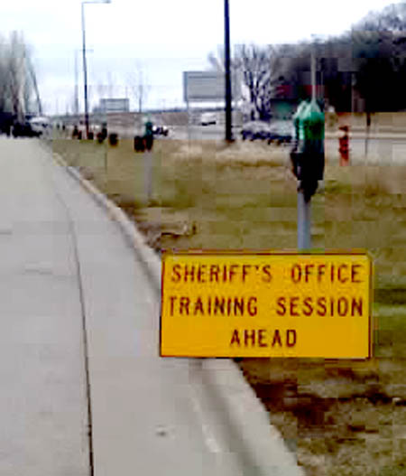 "A sign on the road leading into the Coldwater/Bureau of Mines property on March 24, 2008, showing a sign announcing ""SHERIFF'S OFFICE TRAINING SESSION AHEAD."" The photo was taken by Debbra Myers with her cellpone."