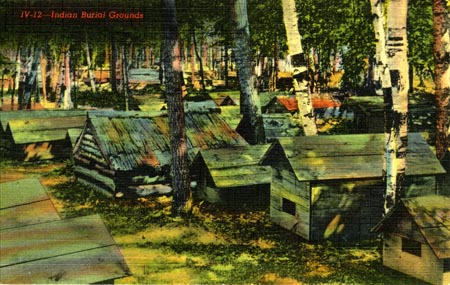 Hand-colored postcard of an unidentifed Ojibwe burial ground somewhere, in the early 1900s