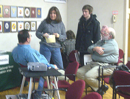 Paul Labovitz and Steven P. Johnson of the National Park Service speaking with Waziyatawin at the Coldwater/ Bureau of Mines open house, February 23, 2009