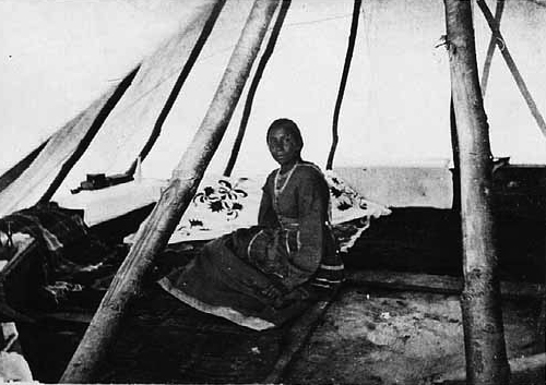 A  Dakota woman sitting in a tepee in the 1870s; Charles Zimmerman photo; Minnesota Historical Society photograph.