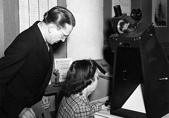 The Minnesota Historical Society has been a pioneer in the creation and use of microfilm as medium for the storage of documents. Here is a view of an early microfilm viewer of the kind used at the Historical Society from the 1930s to the 1960s. Minnesota Historical Society photo.